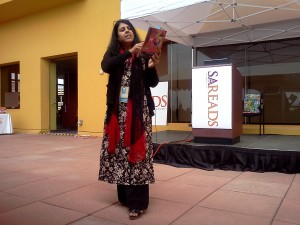 """Photo of Chitra Divakaruni performing her children's book, """"Grandma and the Great Gourd,"""" at the San Antonio Book Festival in 2013."""