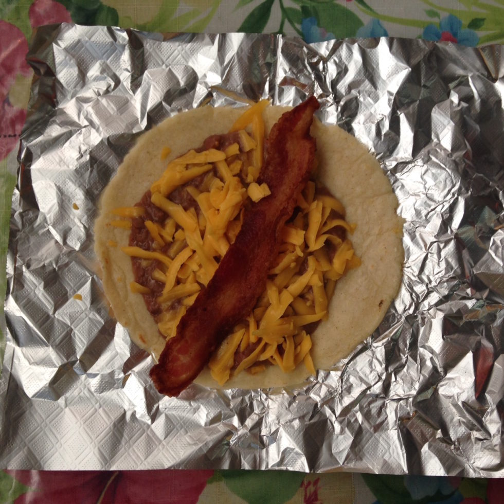 Photo of a bean, cheese and bacon taco at Maria's at 1105 Nogalitos in San Antonio, Texas.